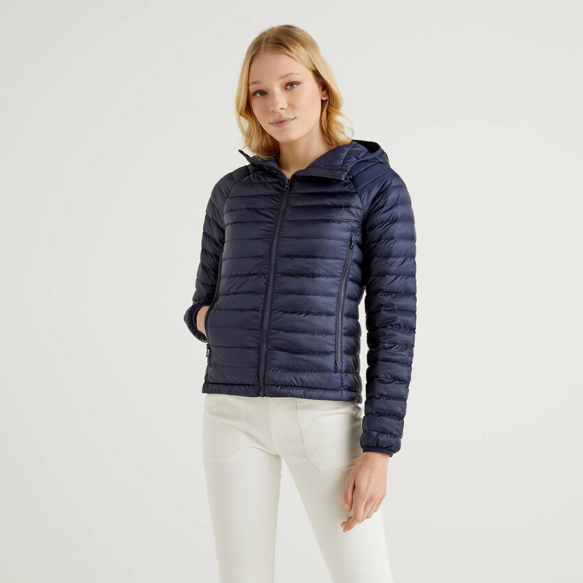 Dark blue puffer jacket with hood
