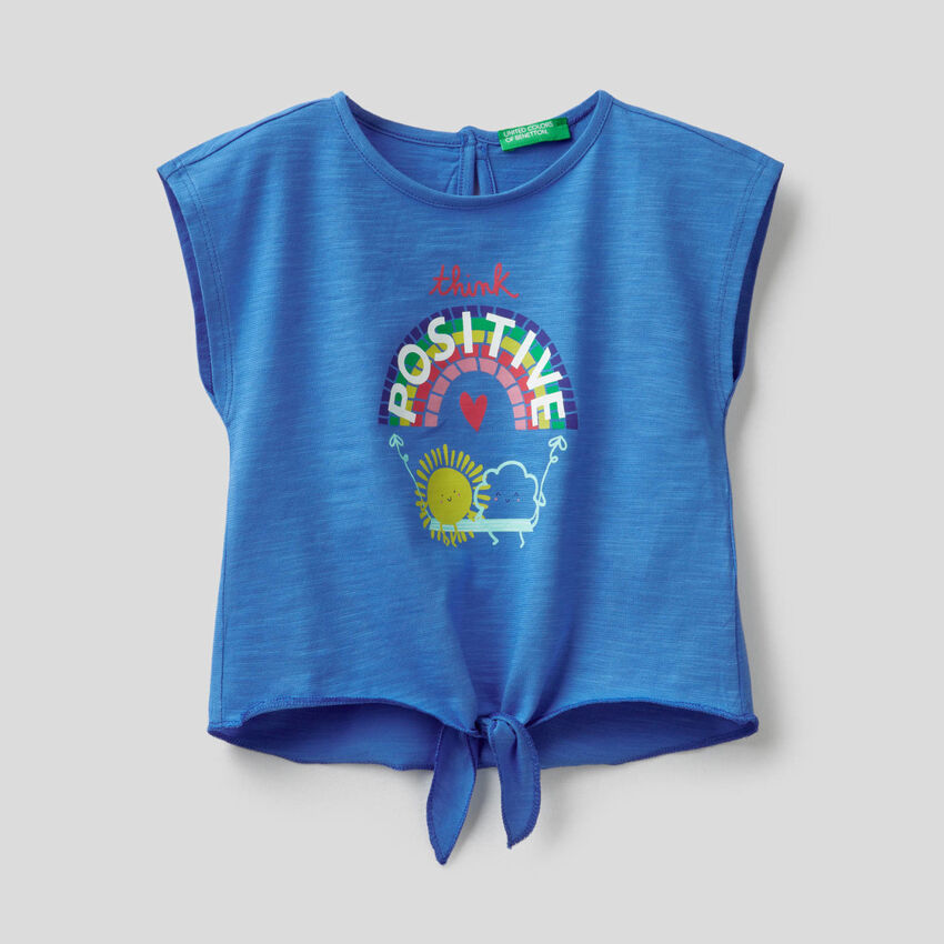 T-shirt in 100% cotton with bow at the bottom
