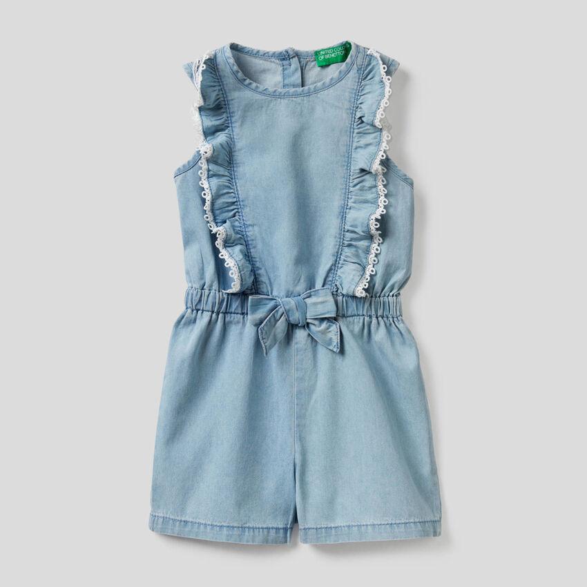 Short jumpsuit in light denim