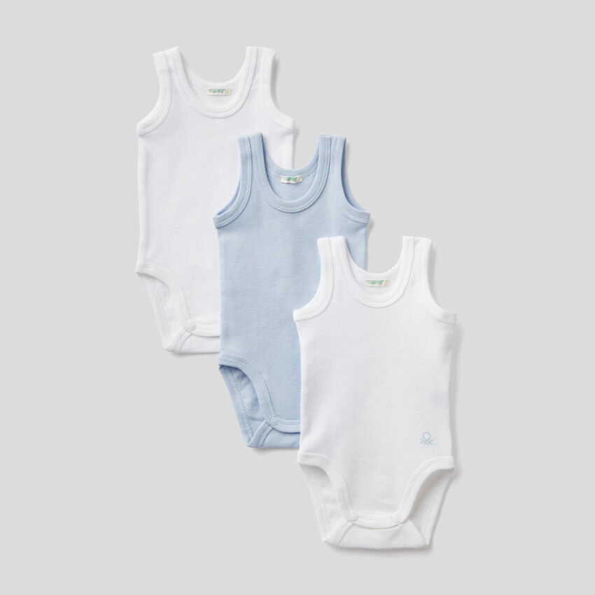 Three solid color tank top bodysuits